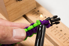 Paracord manual. Serries on how to know a basic paracord bracelet Stock Photography