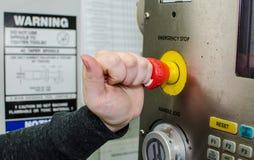 Parada de emergência do botão foto de stock