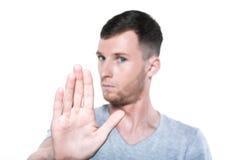 Parada por favor! O homem novo gesticula a palma para você fotografia de stock royalty free