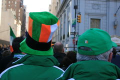 Parade. Men in Irish themed hats watching the St. Patrick's Day Parade in Manhattan Stock Photo