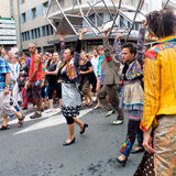 Parade of actors carrying stools. Royalty Free Stock Photography
