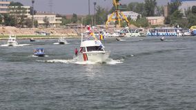 Parade of boats on the Danube. TULCEA, ROMANIA - AUGUST 15: Parade of boats on the Danube on August 15, 2015 in Tulcea, Romania stock video footage