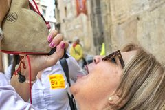 Woman drinking wine in a traditional way at caballos Del Vino in Caravaca de la Cruz, Spain on May 2nd 2019 royalty free stock photography
