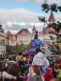 Parade of Cartoon Characters in Disneyland. Paris,France- July 15th 2012: Crowd of spectators following Mikey's festive car during a parade of cartoon characters Royalty Free Stock Image