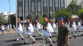 Parade changing of the guard in Athens. Athens, Greece - July 16, 2017: The procession of evzones moves towards the barracks after the ceremonial change of stock video