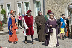 Parade of characters during the medieval festival Royalty Free Stock Photo