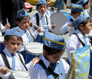 The parade of children in Peru. The parade of children dressed in blue and white clothes playing drums in Peru Stock Images