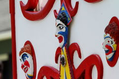 Parade Clowns. Clown faces are displayed on a vehicle at the 4th of July Huntington Beach CA USA parade Stock Photo