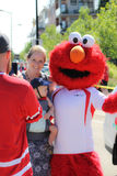 Parade with costume of Elmo and baby and mother Stock Image