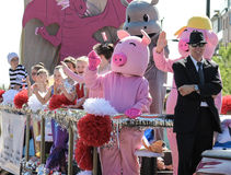 Parade with costumes of pigs and children Stock Photos