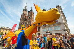During the parade of dragons of Krakow Main Square Stock Photos