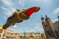 During the parade of dragons of Krakow Main Square Stock Photography