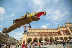 During the parade of dragons of Krakow Main Square Stock Image