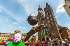 During the parade of dragons on Main Square in Krakow Royalty Free Stock Images