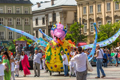 During the parade of dragons on Main Square near St.Mary's Basilica. Royalty Free Stock Image