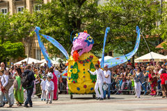 During the parade of dragons on Main Square near St.Mary's Basilica. Stock Photography