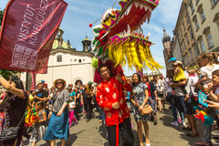 Parade of dragons on Main Square near St.Mary's Basilica in Krakow Stock Photos