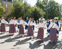Parade of Estonian national song festival in Tallinn, Estonia. Tallinn, Estonia - July 05, 2014: Parade of the Estonian XXVI National song and dance festival Royalty Free Stock Images