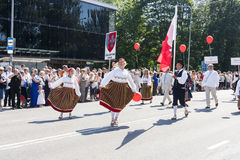 Parade of Estonian national song festival in Tallinn, Estonia. Tallinn, Estonia - July 05, 2014: Parade of the Estonian XXVI National song and dance festival Stock Photo