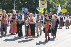 Parade of Estonian national song festival in Tallinn, Estonia. Tallinn, Estonia - July 05, 2014: Parade of the Estonian XXVI National song and dance festival stock photos