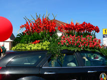Parade flowers. The car is decorated with flowers movement in the column of parade through the streets of Holland Royalty Free Stock Photography