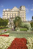 Parade Gardens. Floral lion in Parade Gardens in the historic city of , Bath, Somerset, England. Empire Hotel in the background Stock Photo