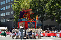 Parade of Gion festival, Kyoto Japan. The parade of Gion Matsuri festival at hot summer day in Kyoto, every float has decorated with historical treasures and art Stock Photo