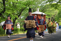 The parade of Kyoto Aoi festival, Japan. Picture of the parade of flowery Aoi hollyhock ceremony, dressed in traditional costumes of ancient imperial family and Stock Photo