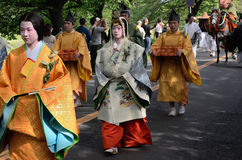 The parade of Kyoto Aoi festival, Japan. Picture of the parade of flowery Aoi hollyhock ceremony, dressed in traditional costumes of ancient imperial family and Royalty Free Stock Image