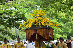 The parade of Kyoto Aoi festival, Japan. Picture of the parade of flowery Aoi hollyhock ceremony, dressed in traditional costumes of ancient imperial family and Stock Images