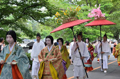 The parade of Kyoto Aoi festival, Japan. Picture of the parade of flowery Aoi hollyhock ceremony, dressed in traditional costumes of ancient imperial family and Stock Photos