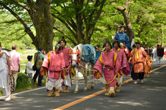 The parade of Kyoto Aoi festival, Japan. Picture of the parade of flowery Aoi hollyhock ceremony, dressed in traditional costumes of ancient imperial family and Stock Image