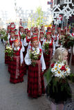 Parade of Latvian Youth Song and Dance festival. RIGA, LATVIA - JULY 10: A parade by festival participants of Latvian Youth Song and Dance Celebration through Stock Photography