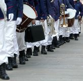 Parade of musicians of the band in full uniform on the town stre Royalty Free Stock Images