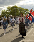 Parade on Norwegian national day. Parade on the Norwegian independence day, a woman in national clothes typical of the northwestern part of the country is in Royalty Free Stock Photography