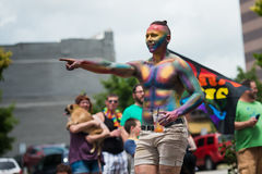 A parade participant is covered in Body Paint. A participant in the 2015 Des Moines Gay pride parade in painted in rainbow coloring Royalty Free Stock Image