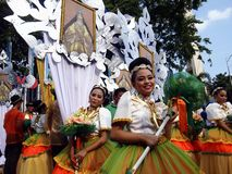 Parade participants in their colorful costumes during the Sumaka Festival in Antipolo City. Royalty Free Stock Images
