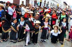 Parade Pase del Nino Viajero, Girls dressed as otavalo people stock photo