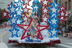 The parade queen and her attendants ride on a float royalty free stock images