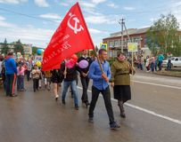 Parade with red flags on victory day with the participation of schoolchildren and parents. Adygea, Russia - May 9, 2017: Immortal regiment, Parade with red flags Royalty Free Stock Photos