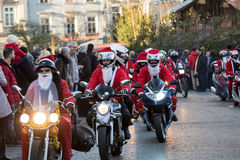 The parade of Santa Clauses on motorcycles around Stock Photo