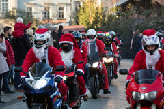The parade of Santa Clauses on motorcycles around Royalty Free Stock Photos
