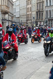 The parade of Santa Clauses on motorcycles around the Main Market Square in Cracow Royalty Free Stock Photography