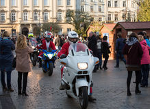 The parade of Santa Clauses on motorcycles around the Main Market Square in Cracow. Poland Stock Image