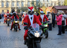 The parade of Santa Clauses on motorcycles around the Main Market Square in Cracow. Poland Royalty Free Stock Photos