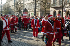 The parade of Santa Clauses on motorcycles around the Main Market Square in Cracow. Poland Royalty Free Stock Photography