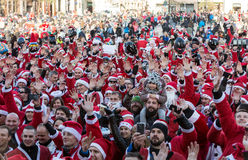 The parade of Santa Clauses on motorcycles around the Main Market Square in Cracow. Royalty Free Stock Photos