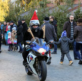 The parade of Santa Clauses on motorcycles around the Main Market Square in Cracow. Royalty Free Stock Photo