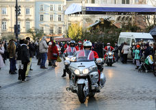 The parade of Santa Clauses on motorcycles around the Main Market Square in Cracow. Stock Photography