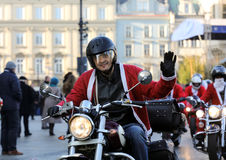The parade of Santa Clauses on motorcycles around the Main Market Square in Cracow. Royalty Free Stock Image